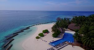 V06728 Aerial flying drone view of Maldives white sandy beach swimming pool in luxury 5 star resort hotel relaxing stock video