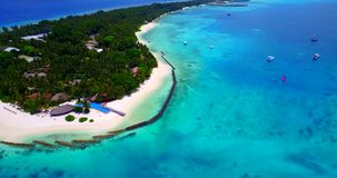 V06669 Aerial flying drone view of Maldives white sandy beach swimming pool in luxury 5 star resort hotel relaxing stock video footage