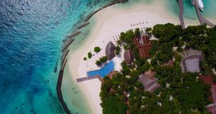 V06752 Aerial flying drone view of Maldives white sandy beach swimming pool in luxury 5 star resort hotel relaxing. Aerial flying drone view of Maldives white stock footage