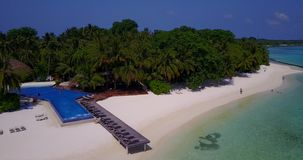 V06666 Aerial flying drone view of Maldives white sandy beach swimming pool in luxury 5 star resort hotel relaxing. Aerial flying drone view of Maldives white stock video footage