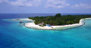 V06713 Aerial flying drone view of Maldives white sandy beach swimming pool in luxury 5 star resort hotel relaxing. Aerial flying drone view of Maldives white stock video