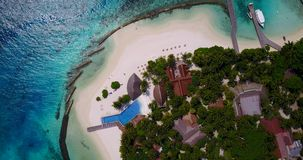 V06701 Aerial flying drone view of Maldives white sandy beach swimming pool in luxury 5 star resort hotel relaxing. Aerial flying drone view of Maldives white stock video footage
