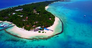 V06672 Aerial flying drone view of Maldives white sandy beach swimming pool in luxury 5 star resort hotel relaxing. Aerial flying drone view of Maldives white stock video