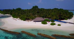 V06667 Aerial flying drone view of Maldives white sandy beach swimming pool in luxury 5 star resort hotel relaxing. Aerial flying drone view of Maldives white stock footage