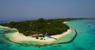 V06731 Aerial flying drone view of Maldives white sandy beach swimming pool in luxury 5 star resort hotel relaxing stock footage