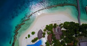 V06732 Aerial flying drone view of Maldives white sandy beach swimming pool in luxury 5 star resort hotel relaxing stock video