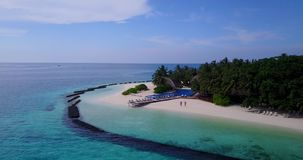 V06724 Aerial flying drone view of Maldives white sandy beach swimming pool in luxury 5 star resort hotel relaxing. Aerial flying drone view of Maldives white stock footage