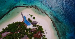 V06671 Aerial flying drone view of Maldives white sandy beach swimming pool in luxury 5 star resort hotel relaxing. Aerial flying drone view of Maldives white stock video