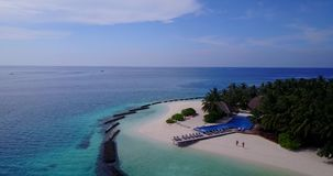 V06723 Aerial flying drone view of Maldives white sandy beach swimming pool in luxury 5 star resort hotel relaxing. Aerial flying drone view of Maldives white stock video