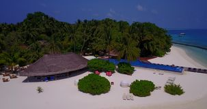 V06715 Aerial flying drone view of Maldives white sandy beach swimming pool in luxury 5 star resort hotel relaxing. Aerial flying drone view of Maldives white stock video footage