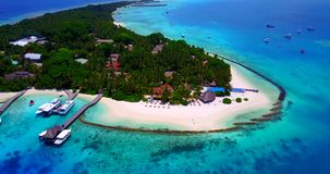 V06664 Aerial flying drone view of Maldives white sandy beach swimming pool in luxury 5 star resort hotel relaxing. Aerial flying drone view of Maldives white stock video