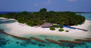 V06730 Aerial flying drone view of Maldives white sandy beach swimming pool in luxury 5 star resort hotel relaxing. Aerial flying drone view of Maldives white stock video footage