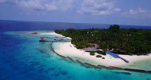 V06712 Aerial flying drone view of Maldives white sandy beach swimming pool in luxury 5 star resort hotel relaxing. Aerial flying drone view of Maldives white stock footage