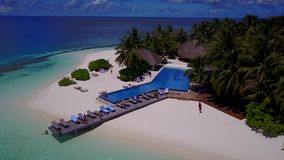 V06720 Aerial flying drone view of Maldives white sandy beach swimming pool in luxury 5 star resort hotel relaxing. Aerial flying drone view of Maldives white stock video footage