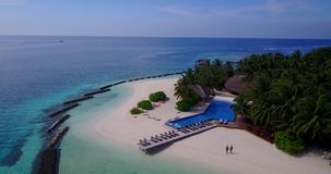 V06727 Aerial flying drone view of Maldives white sandy beach swimming pool in luxury 5 star resort hotel relaxing stock video