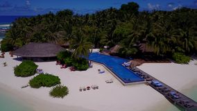 V06717 Aerial flying drone view of Maldives white sandy beach swimming pool in luxury 5 star resort hotel relaxing stock footage