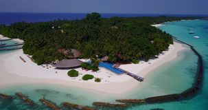 V06749 Aerial flying drone view of Maldives white sandy beach swimming pool in luxury 5 star resort hotel relaxing stock video footage