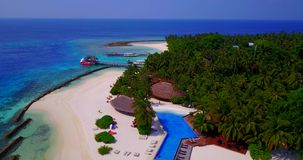 V06703 Aerial flying drone view of Maldives white sandy beach swimming pool in luxury 5 star resort hotel relaxing stock footage