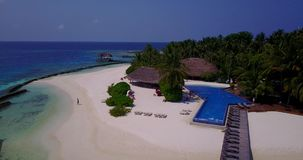 V06697 Aerial flying drone view of Maldives white sandy beach swimming pool in luxury 5 star resort hotel relaxing stock video footage