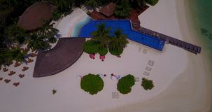 V06698 Aerial flying drone view of Maldives white sandy beach swimming pool in luxury 5 star resort hotel relaxing stock video footage