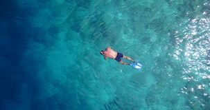 V06447 Aerial flying drone view of Maldives white sandy beach young people snorkeling swimming underwater on sunny Stock Photography