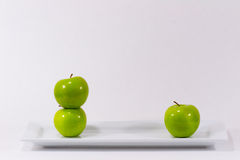 2 v 1 apples Stock Photography