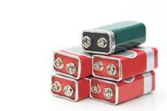 9 v-batterier i perspektivcloseupsikt Arkivfoto