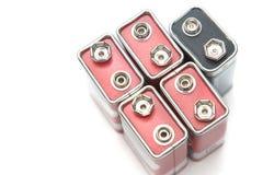 9 v-batterier i perspektivcloseupsikt Arkivfoton