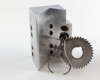 V-Block and Cutter With Spring Calipers. Machined Precision V-Block Part With Cutter With Spring Calipers on a white background Royalty Free Stock Images