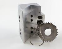 V-bloco e cortador com compassos de calibre da mola imagens de stock royalty free