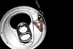 V Charm on Beverage Can stock photos