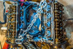 V8 engine from car being rebuilt in garage stock photos