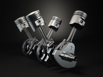 V4 engine pistons and cog on black background. Stock Photo