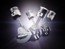 V4 engine pistons and cog on black background. Royalty Free Stock Images