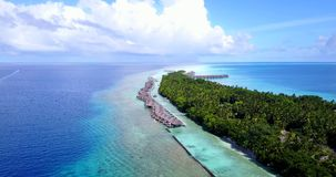 V09499 five 5 star resort water bungalows in Maldives with drone aerial flying view on white sand beach on tropical Stock Image