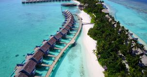 V09539 five 5 star resort water bungalows in Maldives with drone aerial flying view on white sand beach on tropical Royalty Free Stock Photos