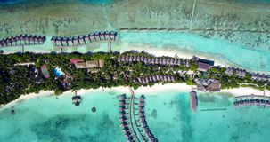 V09490 five 5 star resort water bungalows in Maldives with drone aerial flying view on white sand beach on tropical Stock Photos