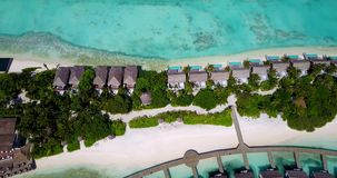 V09413 five 5 star resort water bungalows in Maldives with drone aerial flying view on white sand beach on tropical Royalty Free Stock Photo