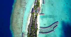 V09409 five 5 star resort water bungalows in Maldives with drone aerial flying view on white sand beach on tropical Royalty Free Stock Photography