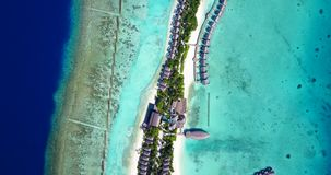 V09420 five 5 star resort water bungalows in Maldives with drone aerial flying view on white sand beach on tropical Royalty Free Stock Photos