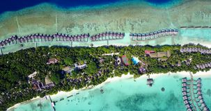 V09492 five 5 star resort water bungalows in Maldives with drone aerial flying view on white sand beach on tropical Royalty Free Stock Images
