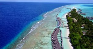 V09411 five 5 star resort water bungalows in Maldives with drone aerial flying view on white sand beach on tropical Stock Photography