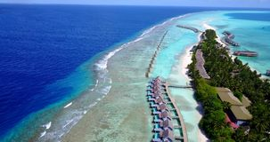 V09416 five 5 star resort water bungalows in Maldives with drone aerial flying view on white sand beach on tropical Royalty Free Stock Photo