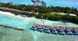 V09516 five 5 star resort water bungalows in Maldives with drone aerial flying view on white sand beach on tropical Royalty Free Stock Images