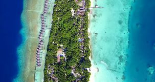 V09509 five 5 star resort water bungalows in Maldives with drone aerial flying view on white sand beach on tropical Royalty Free Stock Photo
