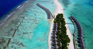 V09435 five 5 star resort water bungalows in Maldives with drone aerial flying view on white sand beach on tropical Royalty Free Stock Photography