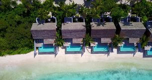 V09549 five 5 star resort water bungalows in Maldives with drone aerial flying view on white sand beach on tropical Royalty Free Stock Images