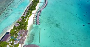 V09532 five 5 star resort water bungalows in Maldives with drone aerial flying view on white sand beach on tropical. Five 5 star resort water bungalows in Stock Photos