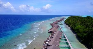 V09563 five 5 star resort water bungalows in Maldives with drone aerial flying view on white sand beach on tropical Royalty Free Stock Images
