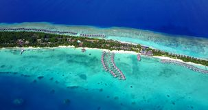 V09474 five 5 star resort water bungalows in Maldives with drone aerial flying view on white sand beach on tropical. Five 5 star resort water bungalows in Royalty Free Stock Images